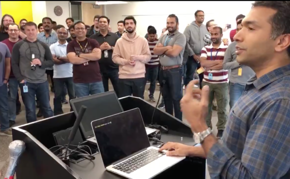 Amazon employees celebrate after switching off their last Oracle database