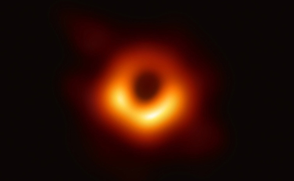 The first ever direct photograph of black hole M87. Image: EHT
