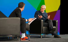 Tim Cook speaking to Aaron Levie. Stock image
