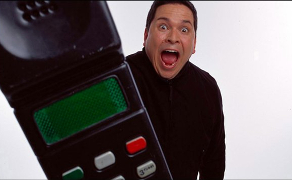 Trigger Happy TV's Dom Joly with his ubiquitous 'large' Nokia mobile phone