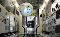 Flying robot joins astronauts aboard ISS