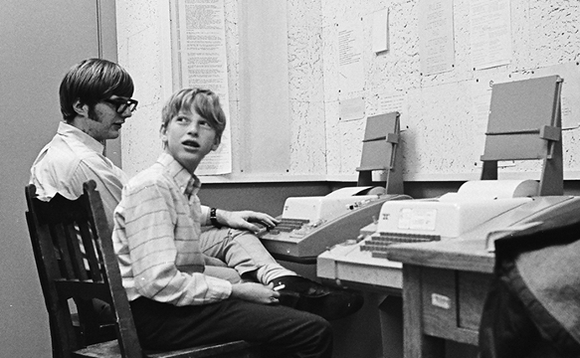 Paul Allen (left) pictured with Bill Gates at a teletype machine at Lakeside School in 1970. Photo by Bruce Burgess