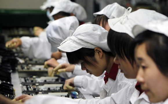 Foxconn workers on the production line - there may be fewer of them in 2018