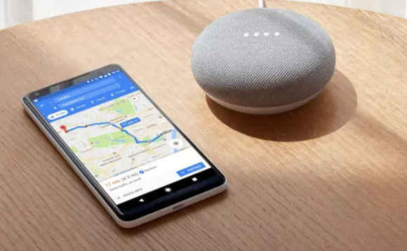 Google Pixel 2 smartphone paired with Google Home Mini virtual assistant